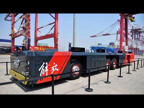 Driverless vehicles arrive at a port in east China
