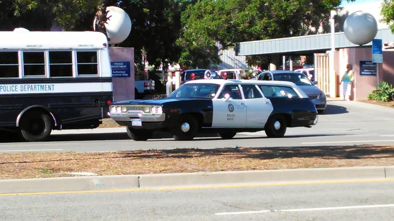 Classic LAPD Cop Cars coming out of Wilshire Division