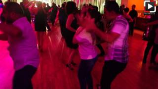 Imelda y Luis dancing salsa at Salrica Dance Houston