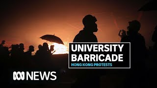 Hong Kong police battle explosions as they move in on protesters barricaded at university | ABC News