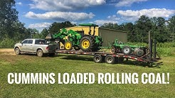 Dodge Cummins hauling a John Deere 5075E and disk to go farming