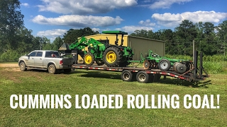 Dodge Cummins hauling a John Deere 5075E and disk to go farming