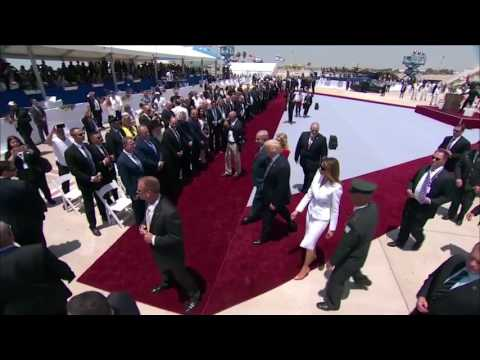 Melania Trump appears to push president's hand away