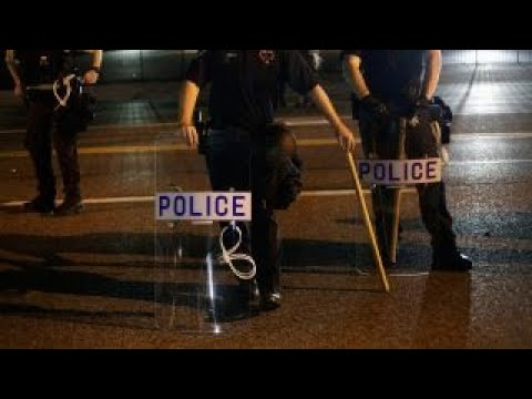 How can society ensure the safety of police officers?