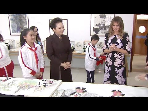 First Ladies Peng Liyuan and Melania Trump help with students