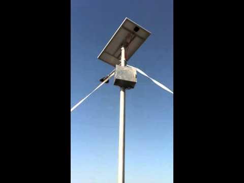 Putting up solar lights - South Sudan
