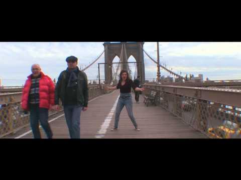 Livia Scott Is Happy On The Brooklyn Bridge In New York City