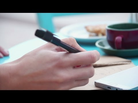 Hands of woman writing in notebook, cup of coffee, smartphone on cafe table. Stock Footage