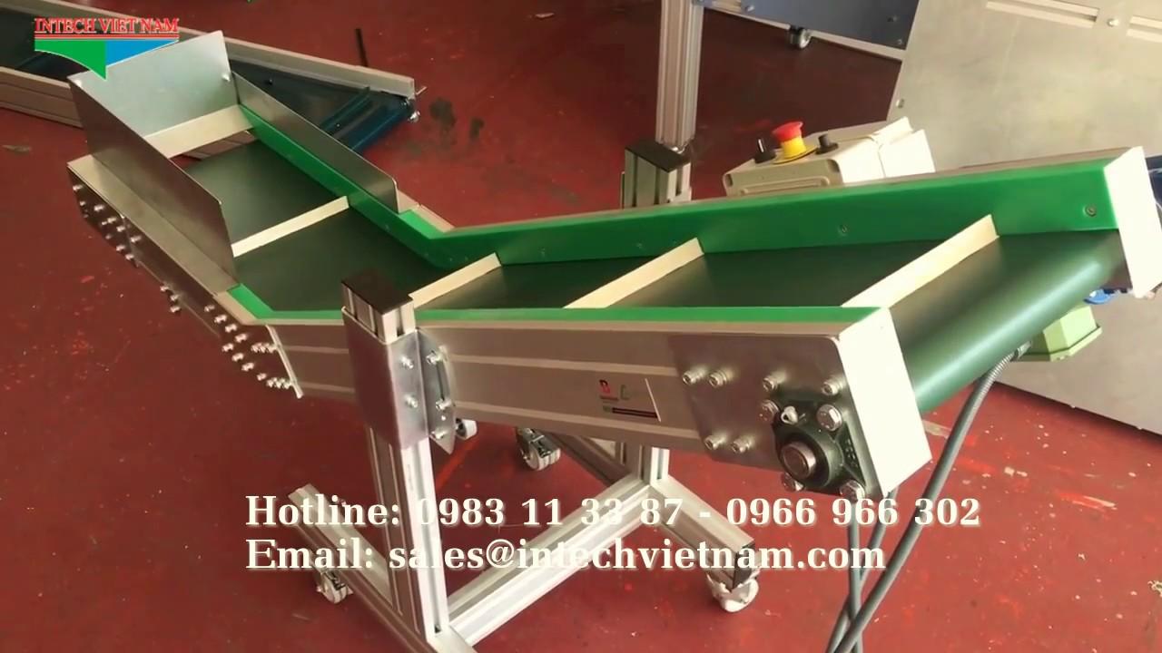 Băng tải cấp liệu – Băng tải nghiêng dán gân PVC
