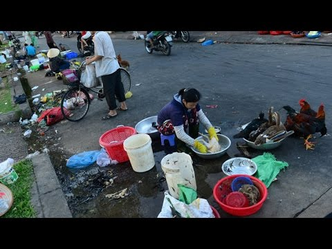 Ho Chi Minh City residents clean houses for Tet while dirtying streets