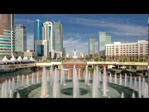 Music fountain and new business district timelapse from bridge in Astana