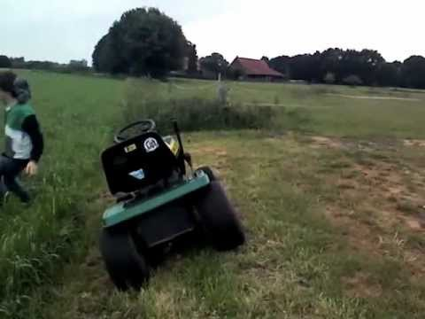 john deere rasenm her traktor jumping over youtube. Black Bedroom Furniture Sets. Home Design Ideas