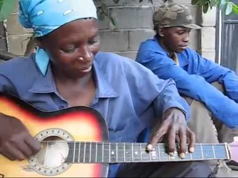 African Woman Plays Guitar (mugithi style)