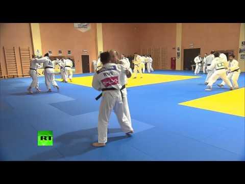 Judo Chop! Putin spars with Russian team in Sochi