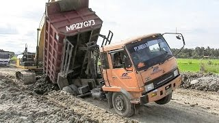 Dump Truck Stuck Recovery By Excavator And Dozer