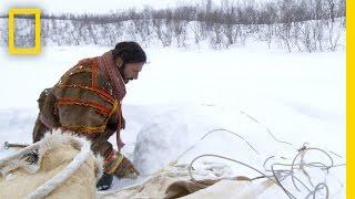 Deep inside the Arctic Circle, Hazen negotiates crossing a river pa...