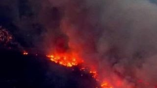 Firefighters make progress fighting California wildfires thumbnail