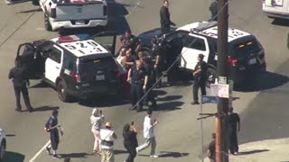 Suspected Car Thief Fist Bumps Onlooker During Police Chase