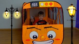 Rinat and Dominika play with little bus