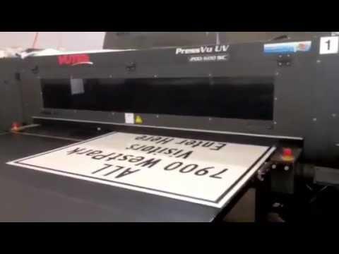 aluminum sign printing on a vutek flatbed uv printer -