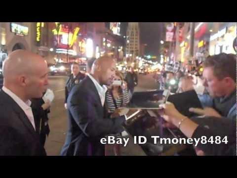 "Dwayne ""the rock"" Johnson signing autograph at Journey 2 premiere"
