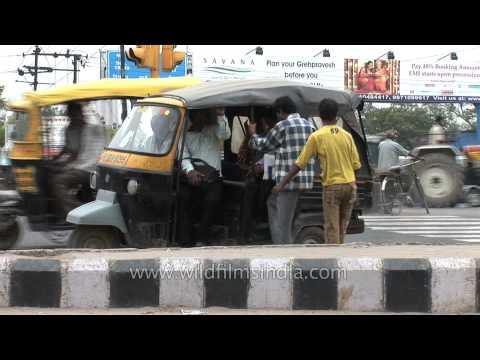 Passengers take lift from auto-rickshaw: Faridabad, Haryana
