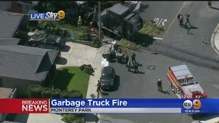 Trash Truck Catches Fire, Rolls Down Hill Into Home