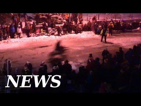 Motorbike rider speeds through closed Sudbury Santa Claus Parade route