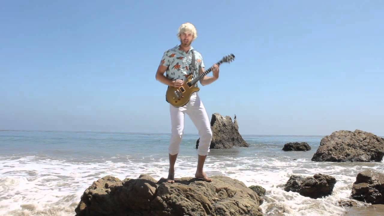 HIDDEN: Rock Guitar  - A hidden video linked to from an annotation in the comedy music video 'Rub Some Bacon on It'.  It shows a guitarist standing on a rock at a beach.