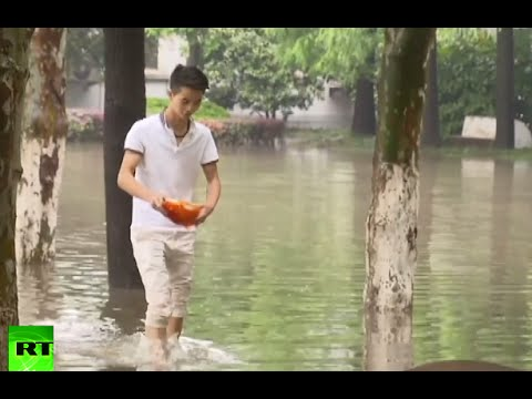 China Floods: Campus Roads Turned Into Rivers, Students Fishing
