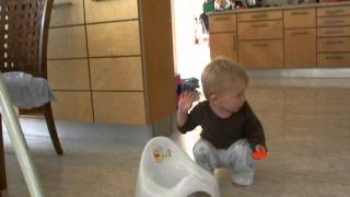 Nathanel - Month 15 - Trying to sit on the potty...