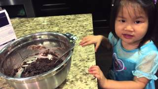 Baking Ghiradelli Double Chocolate Crackle Cookies With Toddler Kyla (wearing A Frozen Elsa Dress)