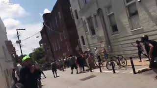 CAR PLOWS INTO DOZENS OF PROTESTERS AT FAR-RIGHT RALLY  Charlottesville Virginia