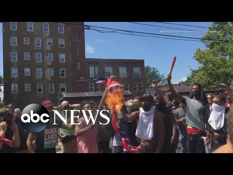 Counterprotesters in Charlottesville, Va., burned a Confederate flag