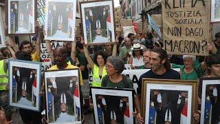 El retrato de Macron como imagen de protesta contra Francia por el G7