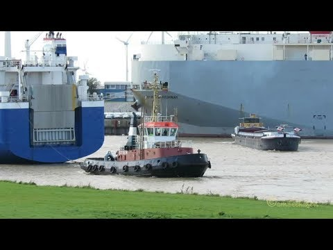 busy seaport traffic Emden Port Hafenverkehr riverbarges tug ferry cargo seaship car carriers