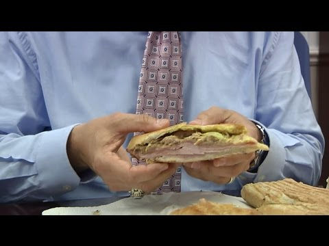 Mayor Rick Kriseman taste tests St. Petersburg's delicious Cuban sandwiches