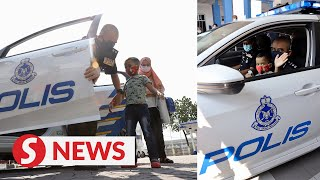 Boy with stage four leukemia gets to be a cop for a day in Penang