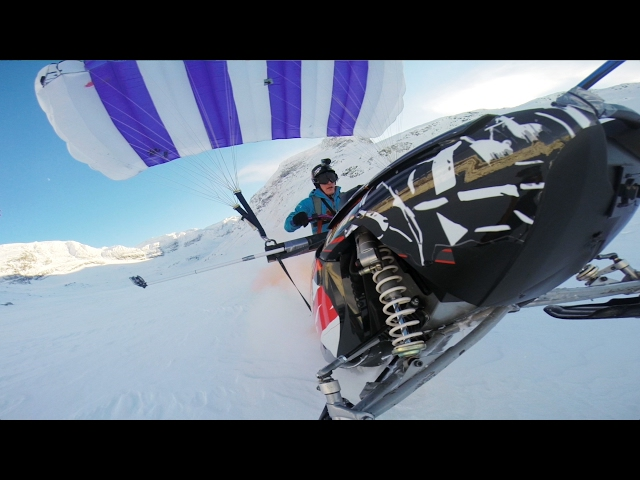 Stunt Man Drives Snowmobile Off Cliff Paraglides Away Video - This is what happens when you fly a snowmobile off a cliff