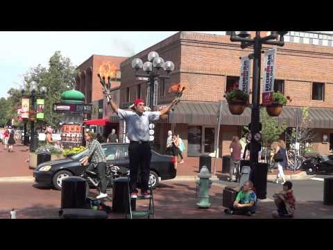 Street performing Fire juggler in Pearl street Mall - 3