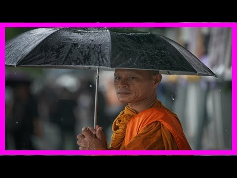 Breaking News | Thailand: crowds camp out in bangkok's torrential rain for king's funeral