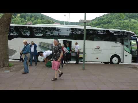 Viking Cruises tour buses and tour groups at Neckarmünzplatz in Heidelberg, Germany