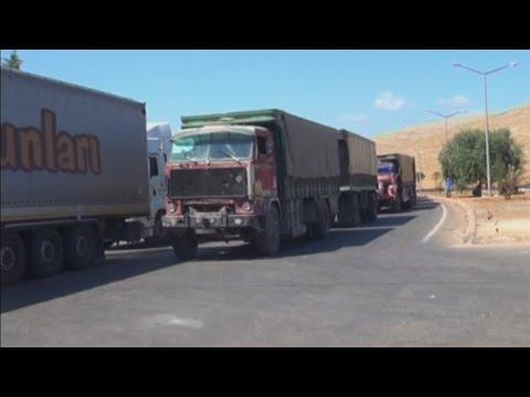 Distributing aid into Syria