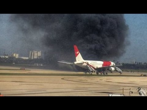 Plane catches fire on runway