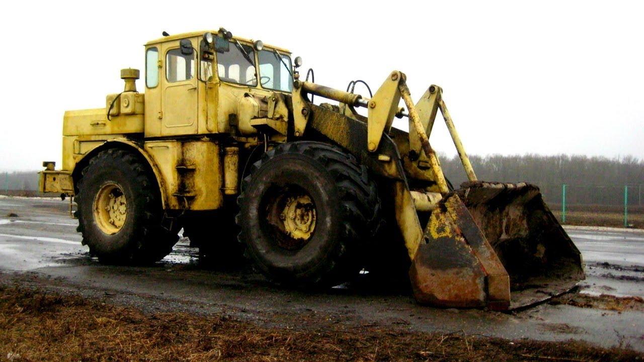 Машины в грязи Трактор чистит дорогу от грязи Трактор месит грязь бездорожье Tractor cleans the road