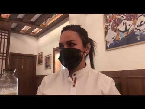 Young Saudi woman serving at restaurant in Riyadh