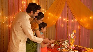 Happy Indian family performing Hindu rituals on the auspicious day of Janamashtmi