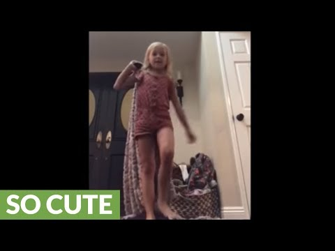 Little girl's magic trick involves adorable canine assistant