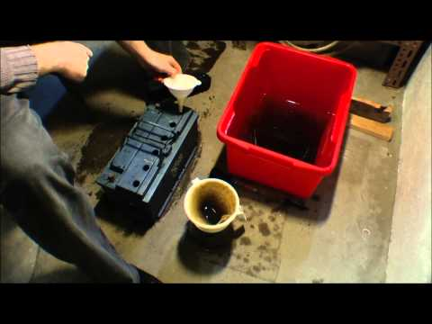 Emptying out a car battery, and filtering the acid - 083