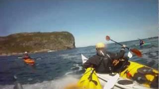 Breaking a sea kayak by hitting a rock